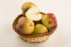 Some pears in a basket over a white background. Fresh fruits royalty free stock image