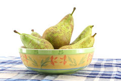 Some pears in a bowl. Of ceramic over a blue checkered tablecloth,  landscape cut Stock Photography