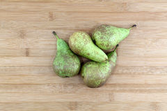 Some pears on a chopping board. Some pears, a wooden chopping board as background, landscape cut Stock Images