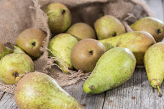 Some Pears. Some fresh green Pears on wooden background stock photo