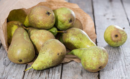 Some Pears. Some fresh green Pears on wooden background royalty free stock images
