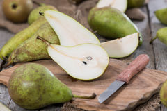 Some Pears. Some fresh green Pears on wooden background stock photography