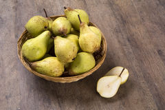 Some Pears In A Basket Over A Wooden Surface Stock Photo