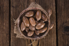 Some Pecan Nuts (selective focus). On wooden background (close-up shot royalty free stock photos