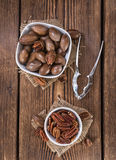 Some Pecan Nuts (selective focus). On wooden background (close-up shot stock images