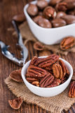 Some Pecan Nuts (selective focus). On wooden background (close-up shot royalty free stock image