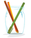 Some pencils inside  glass Stock Images