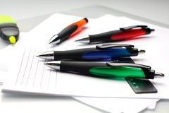 Some pens lie on a white paper. Some pens and ruler lie on a white paper Stock Photography