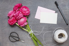 Some peonies with card, envelope and vintage scissors. Top view Royalty Free Stock Image