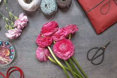 Some peonies with red gift pack and vintage scissors Royalty Free Stock Image