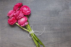 Some peonies on wooden background. Top view Stock Photo
