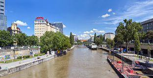 Some people have a break at the Danube Canal of Vienna Stock Photos