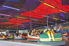 Some people having fun to  drive a bumper car in the amusement p Stock Images
