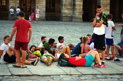 Some people lying on the floor 140. These are some people light on the floor Place: Santiago (Galicia) Spain Date: 15-7-2015 Event: Urban life Stock Photo