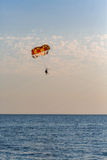 Some people parasailing over the sea. On natural background Stock Photos