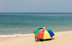 Some people relax on white sand beach. And blue sea Royalty Free Stock Photos