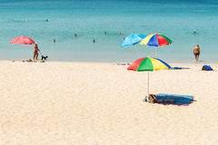 Some people relax on the white sand beach. Phuket,Thailand - March 01, 2016: Some people relax on the white sand beach and blue sea with blue sky background Royalty Free Stock Image