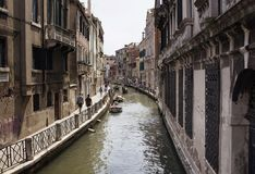 Some people walk by a canal Royalty Free Stock Image