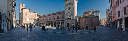 Some people walk in the historic center of Mantua. royalty free stock images