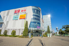 Some people walking in front of Zapp diver city building. Tokyo, Japan - 17 February 2017: Some people walking in front of Zapp diver city building in Odaiba Royalty Free Stock Photos