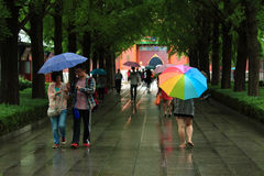 Some people are walking in park of Beijing under Stock Photo