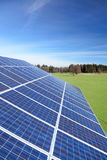 Some photovoltaic cells. On a roof top in nature Royalty Free Stock Image