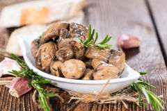 Some pickled Mushrooms. (detailes close-up shot) with fresh herbs stock images