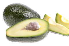 Some pieces of avocado on white background.  royalty free stock images