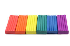 Some pieces of colored plasteli. Some pieces of colored plasticine on a white background stock photography