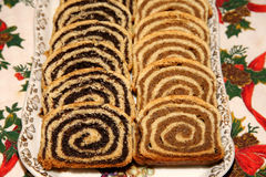 Some pieces of traditional hungarian cake poppy rolls beigli. Homemade traditional poppy seed and walnut rolls for christmas holiday royalty free stock image