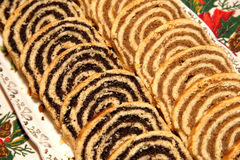 Some pieces of traditional hungarian cake poppy rolls beigli on. Homemade traditional poppy seed and walnut rolls for christmas holiday stock photo
