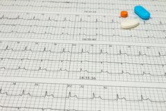 Some pills on electrocardiograms. Records of cardiac activity. Licensed drugs in forms of tablets. Concept of cardiovascular. Some pills on electrocardiograms stock photos