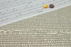 Some pills on electrocardiograms. Records of cardiac activity. Licensed drugs in forms of tablets. Concept of cardiovascular. Some pills on electrocardiograms stock image