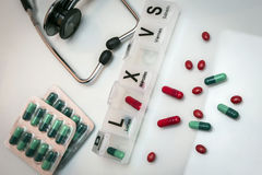 Some pills in a pillbox. Daily medication treatment Royalty Free Stock Photo