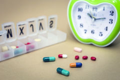 Some pills in a pillbox, daily medication treatment Stock Images
