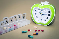 Some pills in a pillbox, daily medication treatment Royalty Free Stock Image