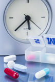 Some pills in a pillbox, daily medication treatment Stock Photo