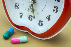 Some pills and red clock Royalty Free Stock Photos