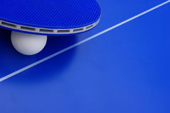 Some ping-pong equipment. Image of a ping-pong ball with a racket on a table Royalty Free Stock Photos