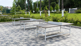 Some ping pong tables in a public park. Outdoor playground with many tennis tables Stock Images