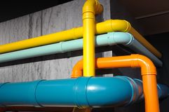 Some pipe fun of colorful painted pipes Stock Images