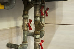 Some pipes and valves coming from boiler house heater.  stock photos