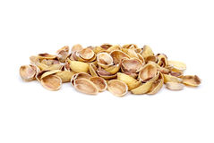 Some pistachio shells. Isolated on the white background Royalty Free Stock Photography