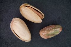 Pistachios over slate Royalty Free Stock Photography