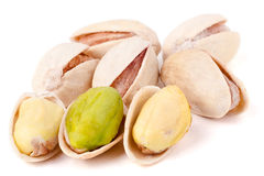 Some pistachios on a white background close up.  stock images