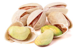 Some pistachios on a white background close up.  royalty free stock images