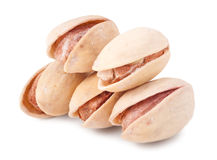 Some pistachios on a white background close up.  stock photos