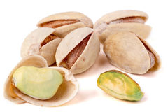 Some pistachios on a white background close up.  stock photography
