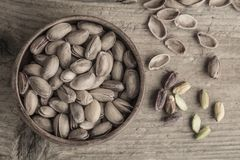 Some pistachios on wooden table. Some pistachios on a wooden table stock images