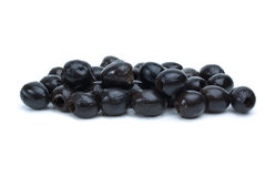 Some pitted black olives. Isolated on the white background royalty free stock images